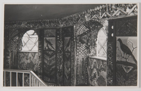 The Shell Gallery, A La Ronde, Devon. Black and white photograph of shell gallery showing 2 windows.