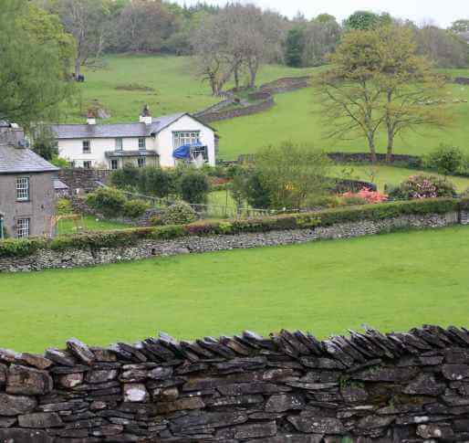 a view of Castle Cottage from the white gate of Hill Top