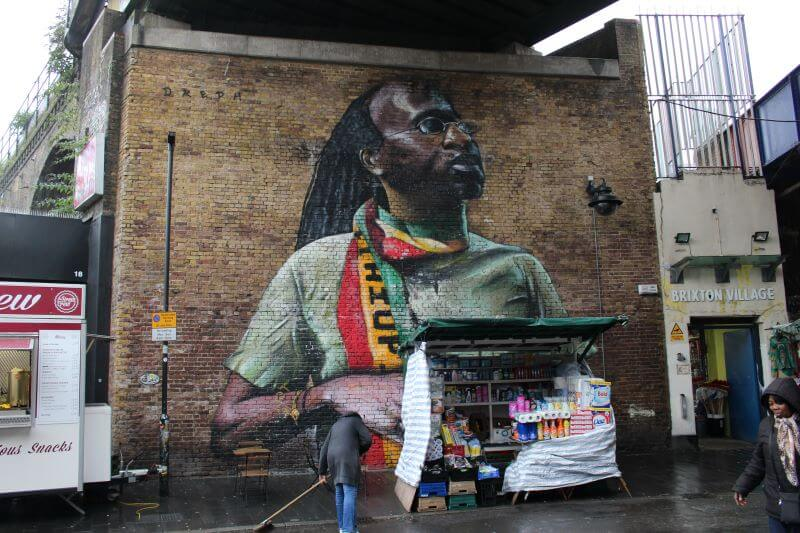 wall paint of a cleaning man at Brixton
