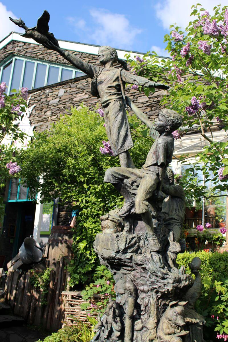 a bronze sculpture at the garden of the World of Beatrix Potter Attraction