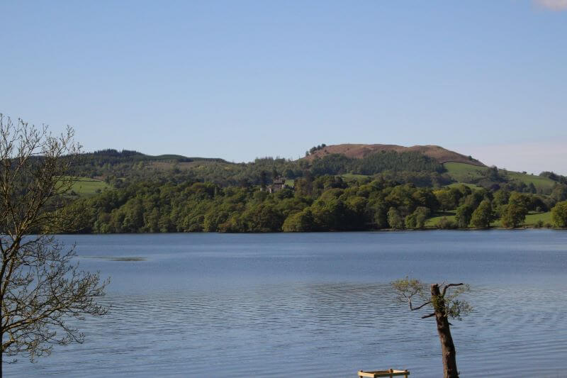 The view of Wray Castle from the opposite shore of Windermere