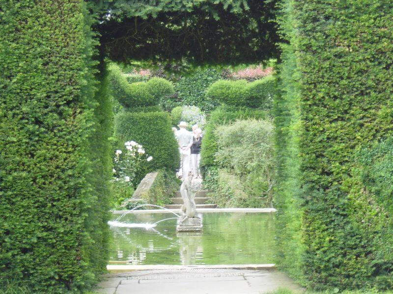 The Bathing Pool Garden to the Fuchsia Garden at Hidcote Manor Garden
