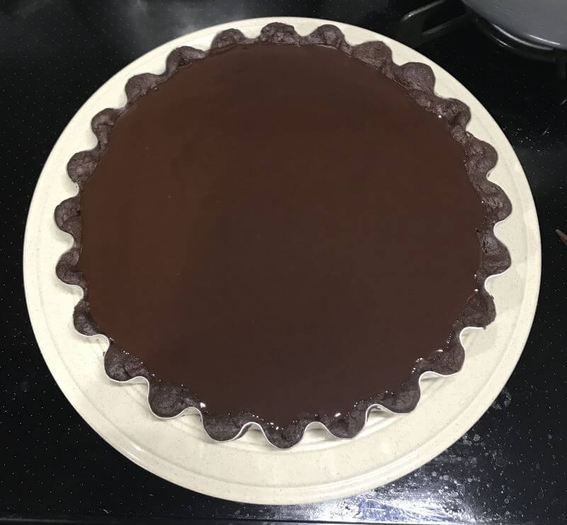 pour melted chocolate into tart
