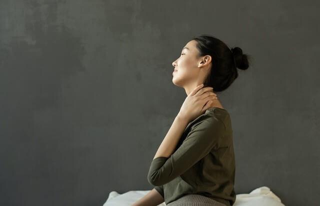 A woman has a stiff neck